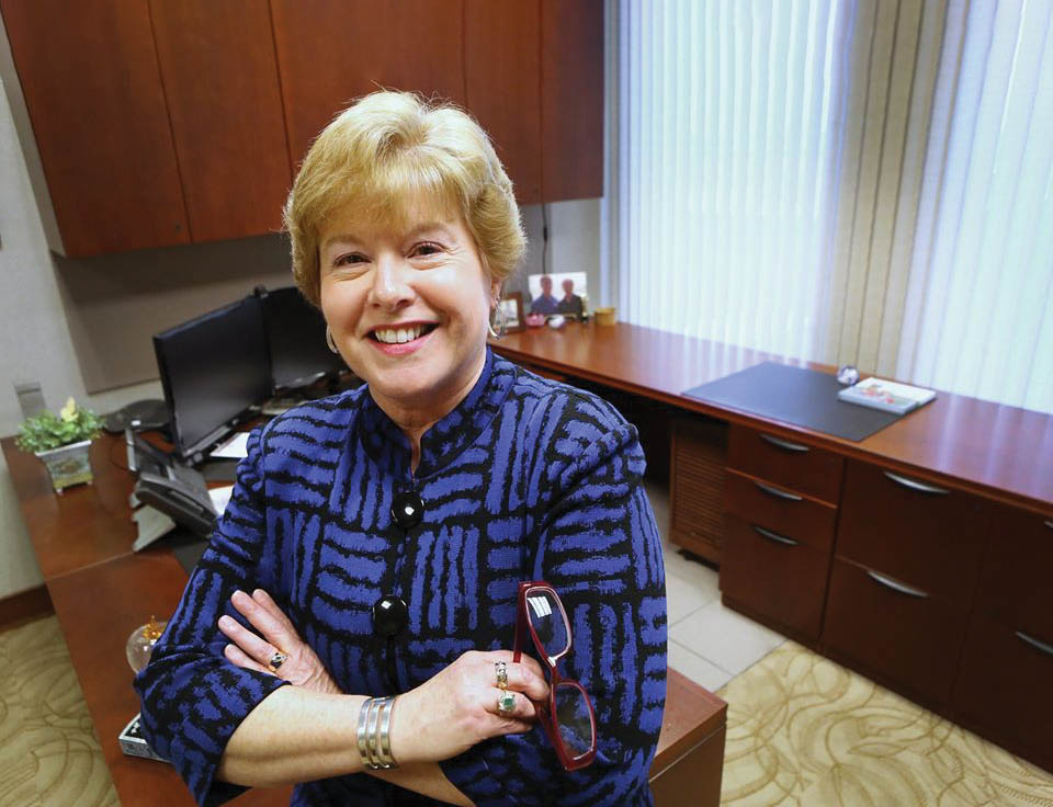 Executive Administrative Assistant Liz Ludwick stands in her office at Muncie Power Products